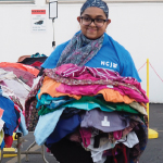 VOLUNTEER at our ANNUAL CLOTHING GIVEAWAY